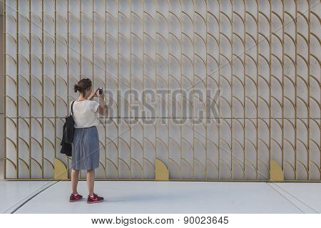 Woman Taking A Pic At Expo 2015 In Milan, Italy