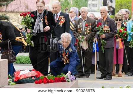 Veterans Laying Flowers At The Monument To Fallen Soldiers