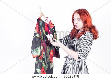 Surprised attractive woman disappointed with the price of the dress