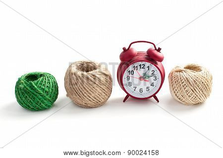 Row Of Thread And Alarm Clock