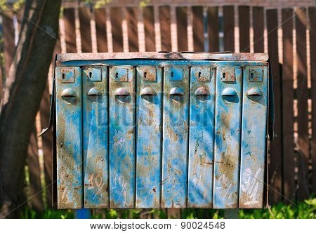 Old Blue Mailboxes With Rust