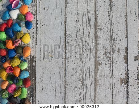 Wooden White Table With Colorful Seashells