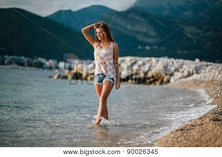 Dreamy Fashion Girl Walk On Beach With Mountains Background