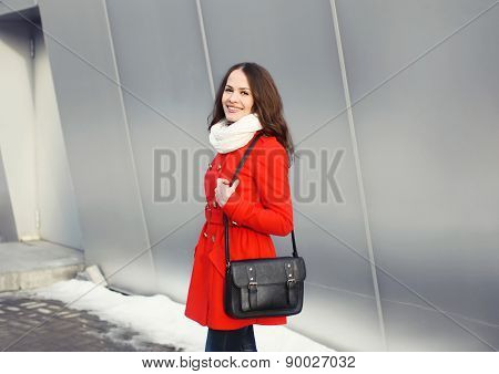 Happy Beautiful Young Woman Dressed A Red Jacket With Black Bag In The City