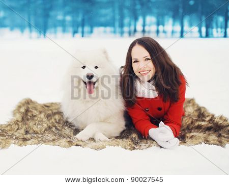 Winter, Christmas And People Concept - Happy Woman Having Fun With White Samoyed Dog Outdoors On The