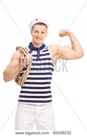 Vertical shot of a male sailor carrying a rope around his shoulder and showing his bicep isolated on white background