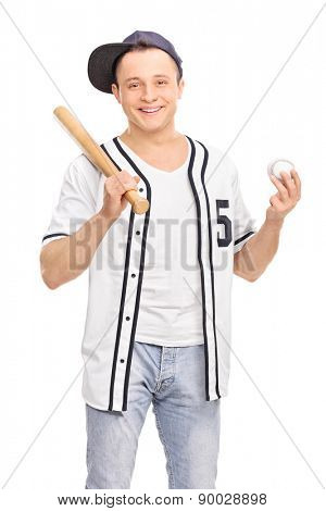 Vertical shot of a young baseball player holding a ball and a baseball bat isolated on white background