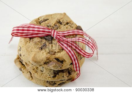 Chocolate Chip Cookies Tied Together With A Red Ribbon