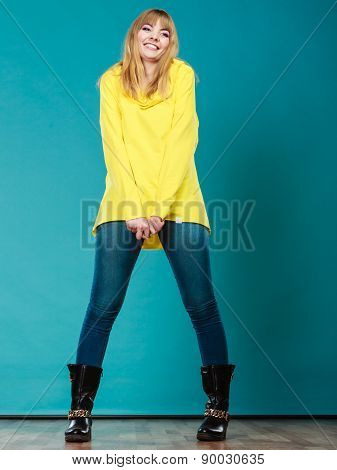 Fashionable Woman In Yellow Blouse Winter Boots