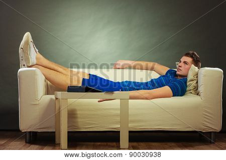 Young Man Relaxing On Couch