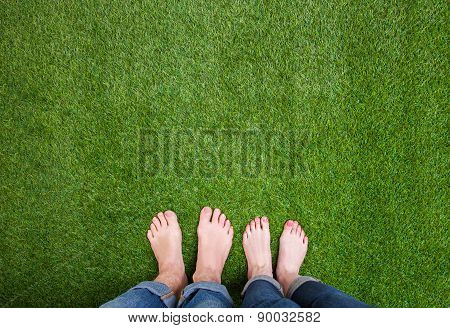 Men and woman  legs standing together on grass