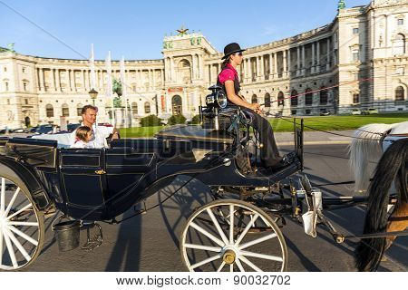 People Have A Ride In The Horsedrawn Carriage Called Fiaker