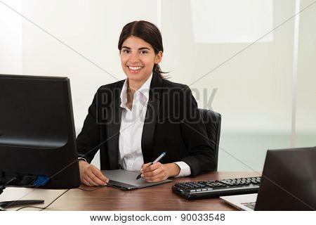 Female Designer With Graphic Tablet At Desk