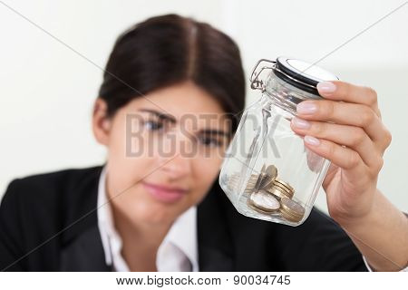 Businesswoman Holding Jar With Coins