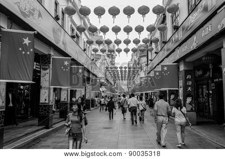 SHENZHEN, CHINA-OCTOBER 05: Shoppers and visitors crowd the famous Dongmen Pedestrian Street on October 05, 2010. This city is regarded as one of the most successful Special Economic Zones.