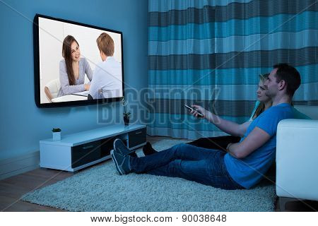 Couple With Remote Watching Movie
