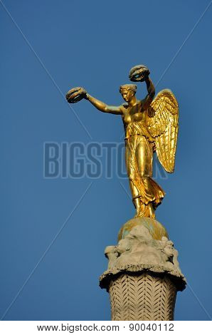 Golden Woman with Wings Statue