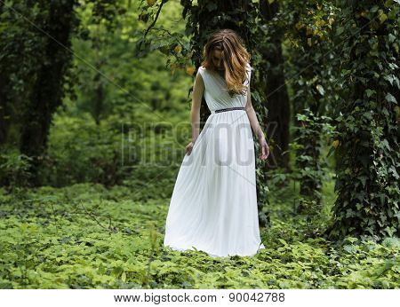 Young girl dressed in a white skirt,  in the park