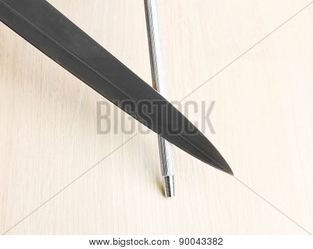 Sharpening knife process on wooden background