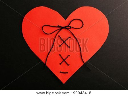 Stitched heart on black background