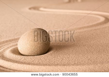 zen stone and sand in Japanese meditation garden. Spa wellness background for balance and spirituality.