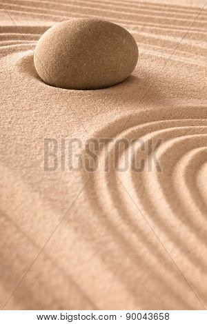zen background with round stone and lines in the sand. Japanese zen garden for relaxation and meditation