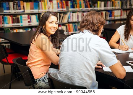 Cute Girl Studying With Friends