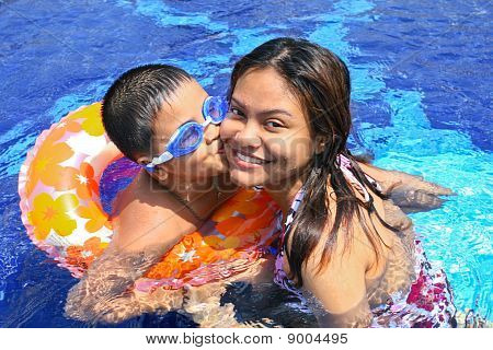 Happy Boy Kiss Mom In The Pool
