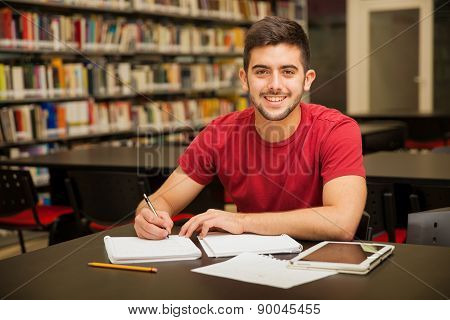Happy Student Doing Homework
