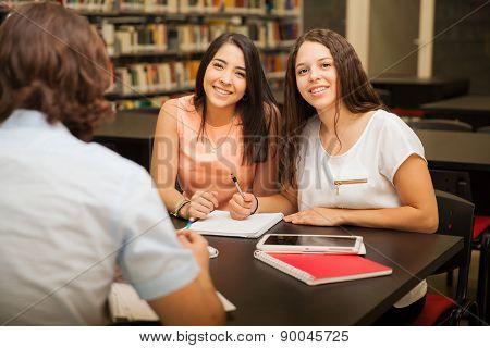 Cute Female Friends In A Library