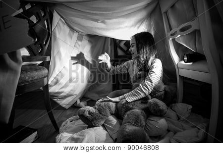 Cute Girl Making Shadow Of Dog With Hands And Flashlight