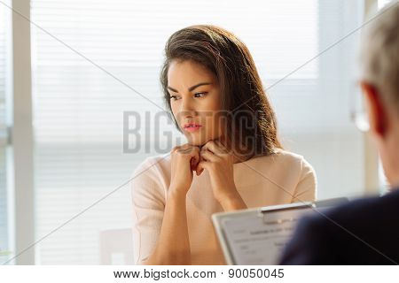 Stressed pensive young woman