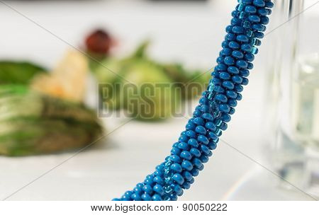 Fragment Of A Knitted Necklace From Blue Beads Close Up