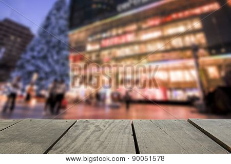 Defocus And Blur Image Of Terrace Wood And Modern Shopping Mall