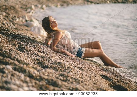 Dreamy Girl Relax On Beach  In Fashion Jeans Shirts