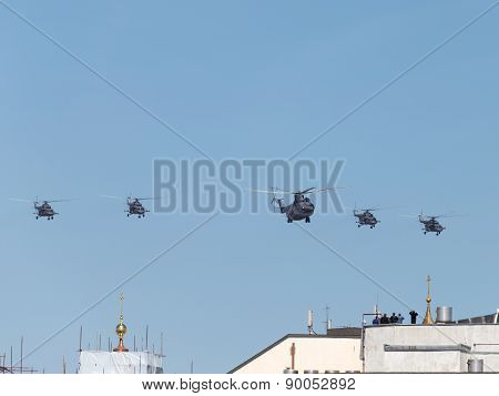 People Watching The Flight Of Helicopters On The Roof