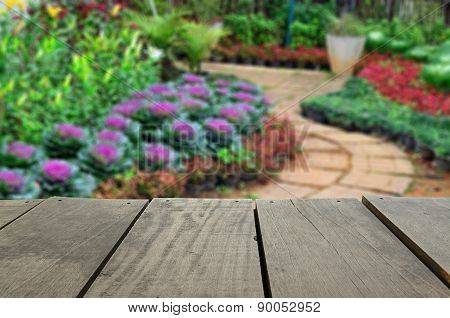 Defocused And Blur Image Of Terrace Wood And Beautiful Walkway Park