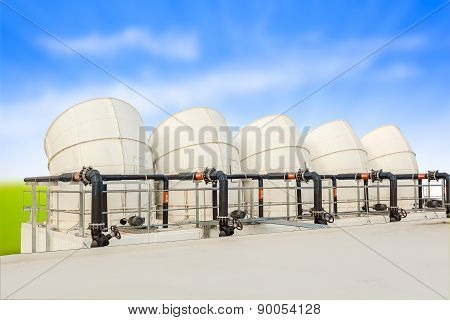 Ventilation Pipes Of Industrial Building Roof Top And Blue Cloud Sky Background