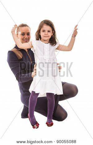 Happy Mom With Dancing Girl