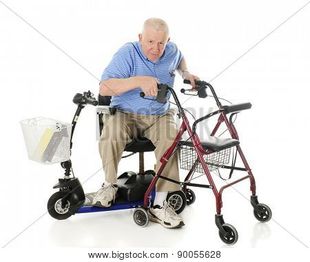 A senior man transferring from his electric scooter to his wheeling walker.  On a white background.