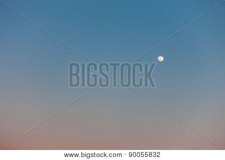 Full Moon in daylight sky