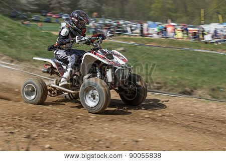 Dynamic Shot Of Young Quad Rider