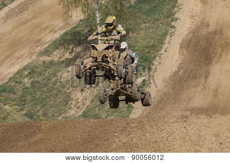 Two Quad Riders Are Jumping Behind