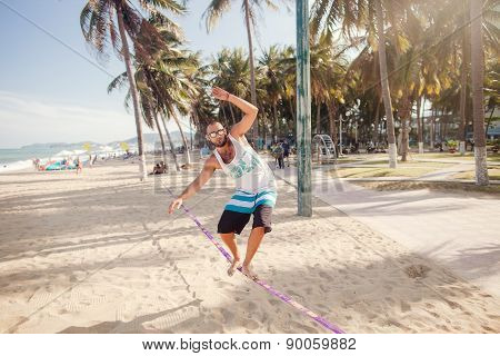 Man Balancing On The Rope