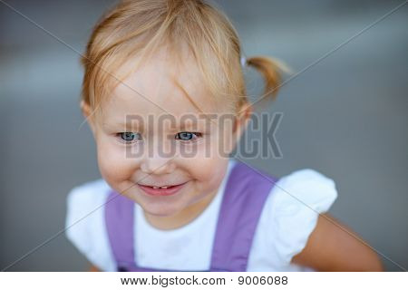 Closeup Portrait Of Adorable Playful Girl