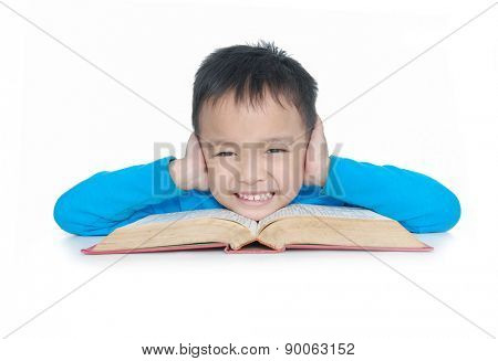 Portrait of a schoolboy sitting at table with book
