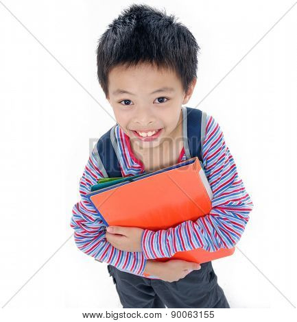 Nice child holding a book standing