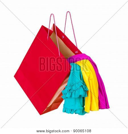 Red Shopping Bag With Colorful Clothes Falling In The Air. Concept Of Shopping