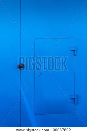 Bright Blue Locked Door And Padlock