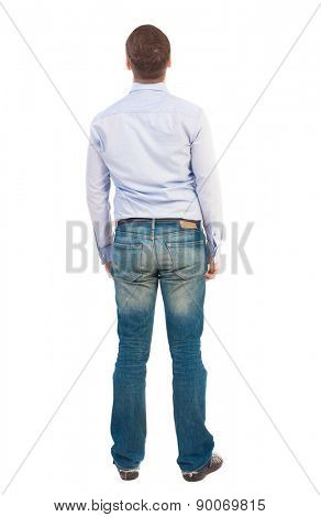 Back view of man in jeans. Standing young guy. Rear view people collection.  backside view of person.  Isolated over white background. Business man in shirt and jeans looking up.